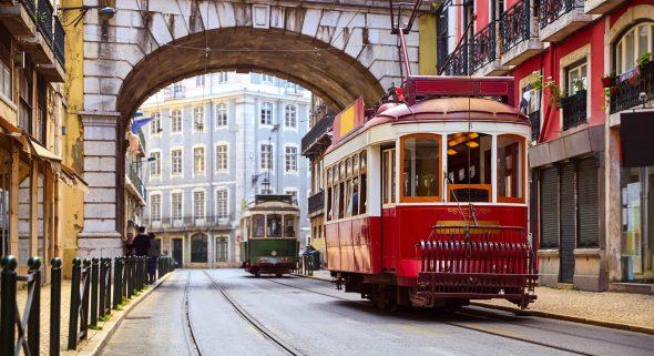 Lisbon,,Portugal.,Vintage,Red,Retro,Tram,On,Narrow,Bystreet,Tramline